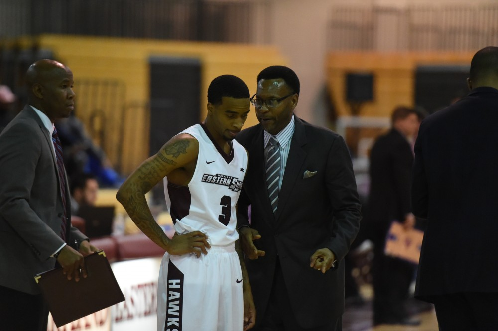 Coach Clifford Reed instructs a player.